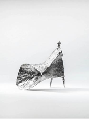 Girl Walking Into Wind